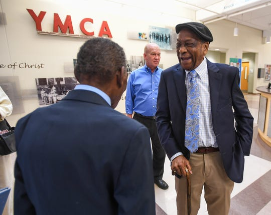 Dr. Charles H. Davis, left, congratulates Leroy Richardson, the longest-serving employee of the Greenville YMCA, during Richardson's retirement party at the Caine Halter Family YMCA in Greenville Thursday, September 20, 2018.