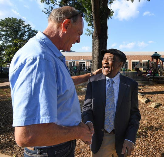 Bo Gossett, left, congratulates Leroy Richardson, the longest-serving employee of the Greenville YMCA, during Richardson's retirement party at the Caine Halter Family YMCA in Greenville Thursday, September 20, 2018.