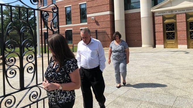 S.C Irish Traveler Johnny Sherlock, center, leaves federal courthouse Thursday, Sept. 20, 2018.
