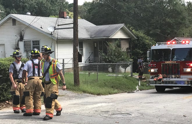 Greenville firefighters put out a fire at a home on Clark Street in the city on Friday, Sept. 21, 2018.