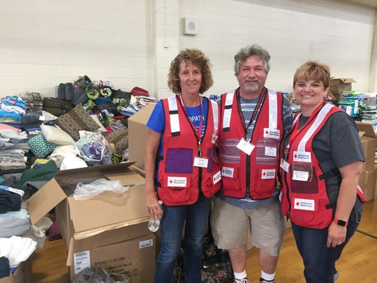 Shellie Creveling, right, is pictured with Red Cross volunteers Cherie Stoddard, left, a volunteer from Idaho Falls, and Ray Lind from Rock Island, Ill.