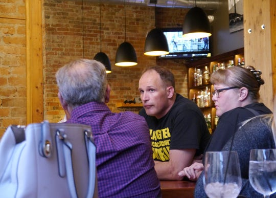 Cascade County Sheriff candidate Jesse Slaughter converses with community members at a downtown Great Falls campaign event Wednesday, Sept. 12, 2018.