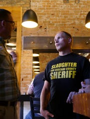 Cascade County Sheriff candidate Jesse Slaughter listens to the concerns of a community member at a campaign event in downtown Great Falls Wednesday, Sept. 12, 2018.