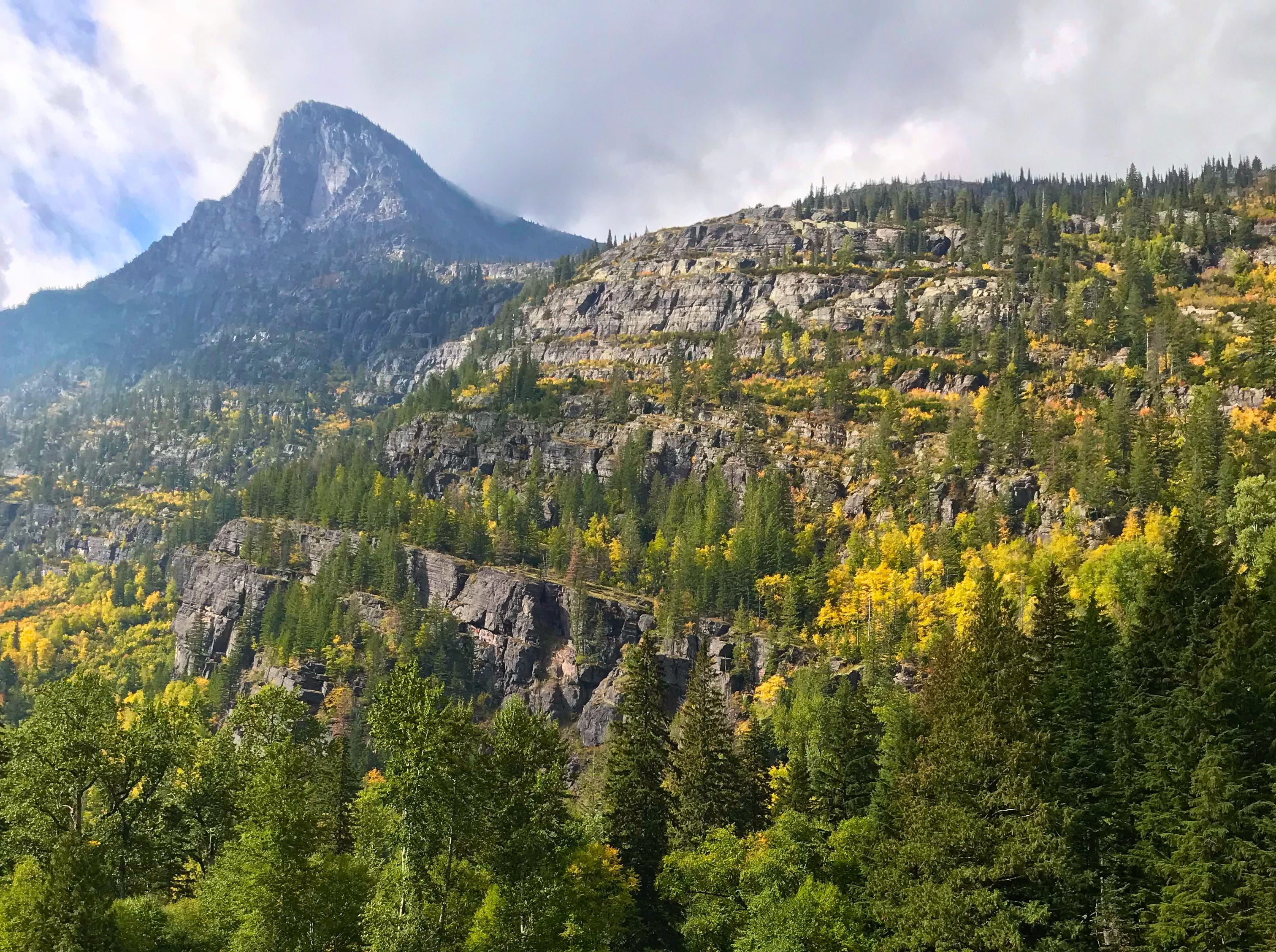 Fall colors glow at Red Rock Point along Glacier National Park's Going-to-the-Sun Road.