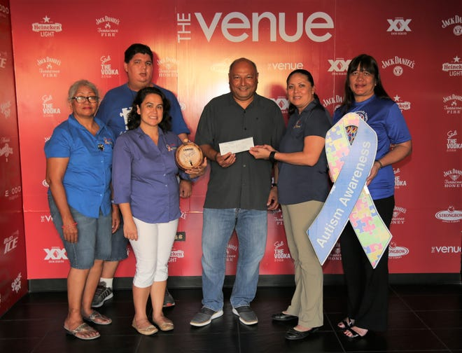 "Phil Roberto, owner of the Venue, at center, presented a donation to The Autism Community Together of Guam, a support group for individuals with autism spectrum disorders and their families.  The donation was a result of a ""Negroni Week"" celebration which benefits various charities around the world and provides a portion of proceeds to a local nonprofit organization. Pictured from left:  Lourdes Bascon-Mendiola, ACT board member; Clifford Mendiola, her son; Kristal Flores, ACT vice-president; Phil Roberto; Josephine Blas, ACT president; and Evelyn Claros, ACT board member."