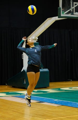 Samyra Tate Duenas serves for the UOG Tritons against Guam Community College Sept. 20 in a Guam Women's College Volleyball League match.