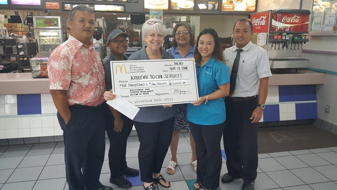 Staff and management of McDonald's and Karidat Social Services with Sen. Paul Manglona, pose for a group photo after McDonald's donated  $5,000 to the charitable institution.  Karidat is grateful for the recent donation from McDonald's. They will  utilize McDonald's donation to support  Typhoon Mangkhut's victims in Rota.