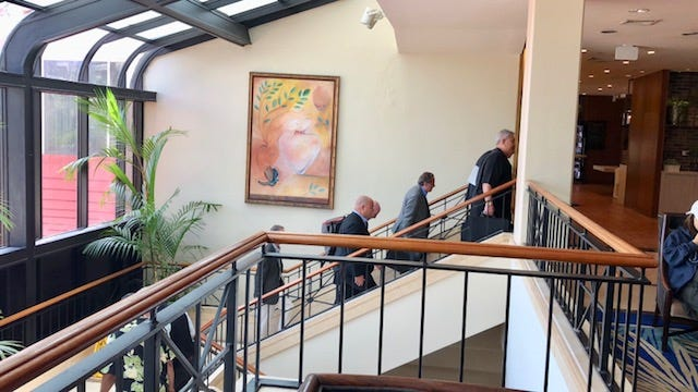 Attorney David Lujan and other lawyers for plaintiffs and defendants in nearly 200 Guam clergy sex abuse claims emerge from the meeting room on Monday, the first day of the week-long mediation to try to settle the cases. The Archdiocese of Agana on Friday said no global settlement has been reached but the process of negotiation continues.