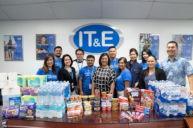 IT&E associates and management in Guam and Saipan donate necessities and supplies to the victims of Typhoon Mangkhut. Donations include non-perishable food items, batteries, diapers, toiletries, and 300 cases of bottled water.