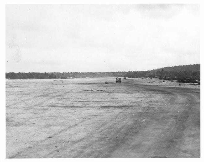 August 12, 1944. Airstrip (Tiyan) built by the Japanese about three miles northwest of Agana. USS Indianapolis (CA 35)  (National Archives 80-G- 248089).