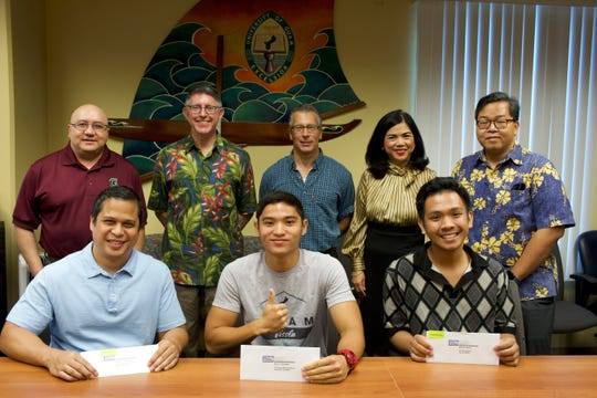 Brown and Caldwell awarded five $1,000 scholarships to University of Guam pre-engineering and environmental science students today. The scholarships were the fourth set in a five-year collaborative program between UOG and the engineering firm. To date, the firm has awarded $15,000 to UOG students pursuing degrees in the sciences. Back row from left: Lawrence F. Camacho, dean of Enrollment Management & Student Success at UOG; Thomas W. Krise, president of UOG; John Riegel, senior program manager for Brown and Caldwell; Anita Borja Enriquez, senior vice president of Academic & Student Affairs at UOG; Mark A. Duarte, director of Financial Aid at UOG. Front row from left: Scholarship recipients Daniel Superales, environmental science graduate student; Brian Barcinas, pre-engineering major; and Edriel Aquino, pre-engineering major. Not shown: scholarship recipients Giordan R. Kho and Victoria C. Lopez, both pre-engineering majors.