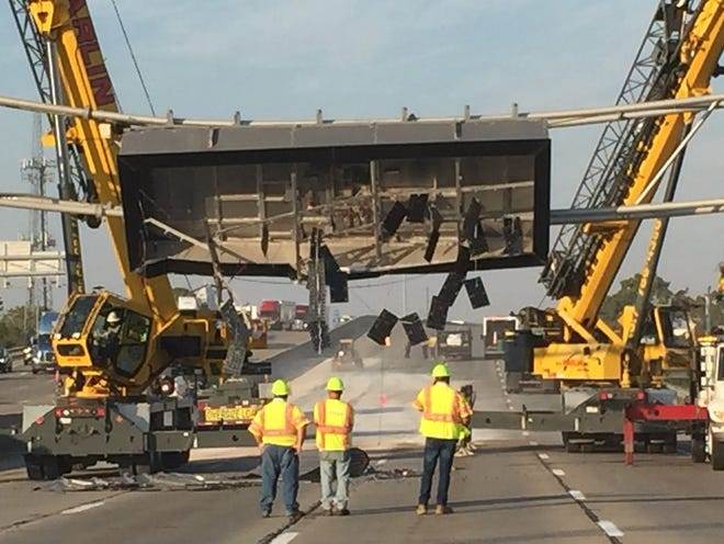I-70 westbound closed at Emerson after dump truck hits message board sign.