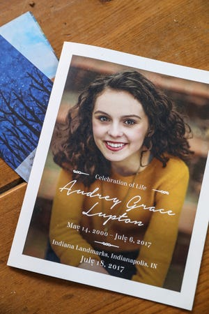 """A program from the celebration of life for Audrey Lupton is seen at her family's home in Indianapolis, Thursday, Sept. 20, 2018. When the 17-year-old University High School student lost her battle with cancer in July 2017, she left bucket lists for her parents and brother. Suzann and JB said the lists are a mix of simple tasks and broad goals that encourage her parents to """"just keep living."""" For example, Audrey wished for her mother to continue art lessons and for the family to travel."""