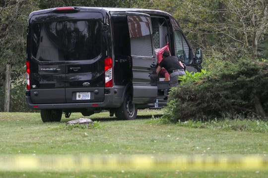 The scene where police are investigating the deaths of a father and two children as a double murder-suicide in an area northeast of Northfield in rural Boone County, near Zionsville, Ind., Friday, Sept. 21, 2018. After their mother was unable to contact the children, police found Michael Hunn, 50, and Zionsville students Harrison Hunn, 15 and Shelby Hunn, 13, dead inside Michael's home at around 11 a.m. Friday.