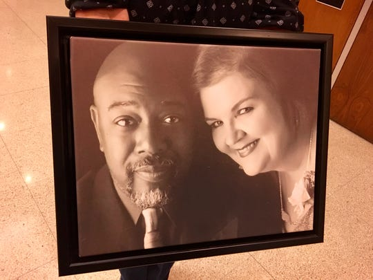 Deborah Monroe carried this portrait of her and her husband, Jeffrey, into the sentencing of Manuel Orrego-Savala on Friday. The portrait was taken during their 21st wedding anniversary which they celebrated in Venice.