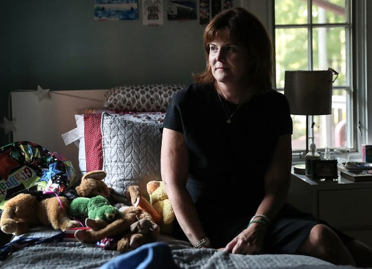 """Suzann Lupton poses for a picture in her late daughter Audrey's bedroom at their home in Indianapolis, Thursday, Sept. 20, 2018. When the 17-year-old University High School student lost her battle with cancer in July 2017, she left bucket lists for her parents and brother. Suzann and JB said the lists are a mix of simple tasks and broad goals that encourage her parents to """"just keep living."""" For example, Audrey wished for her mother to continue art lessons and for the family to travel."""