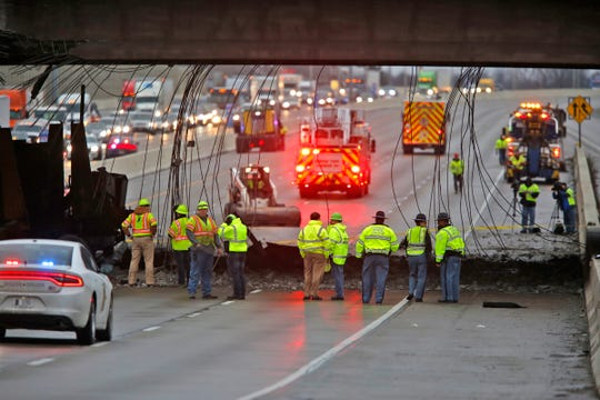 Investigation and cleanup continues at the Rockville Rd. overpass at I465, Tuesday, January 10, 2017.  A truck carrying a car crusher hit the overpass raining debris down on cars.