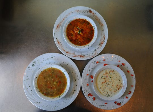 Strawberry Cafe co-owner Eric Bach is known for his attention to detail in creating delicious soups, including, from left, clockwise, chicken and vegetable, chicken and seafood Creole and crab soup.