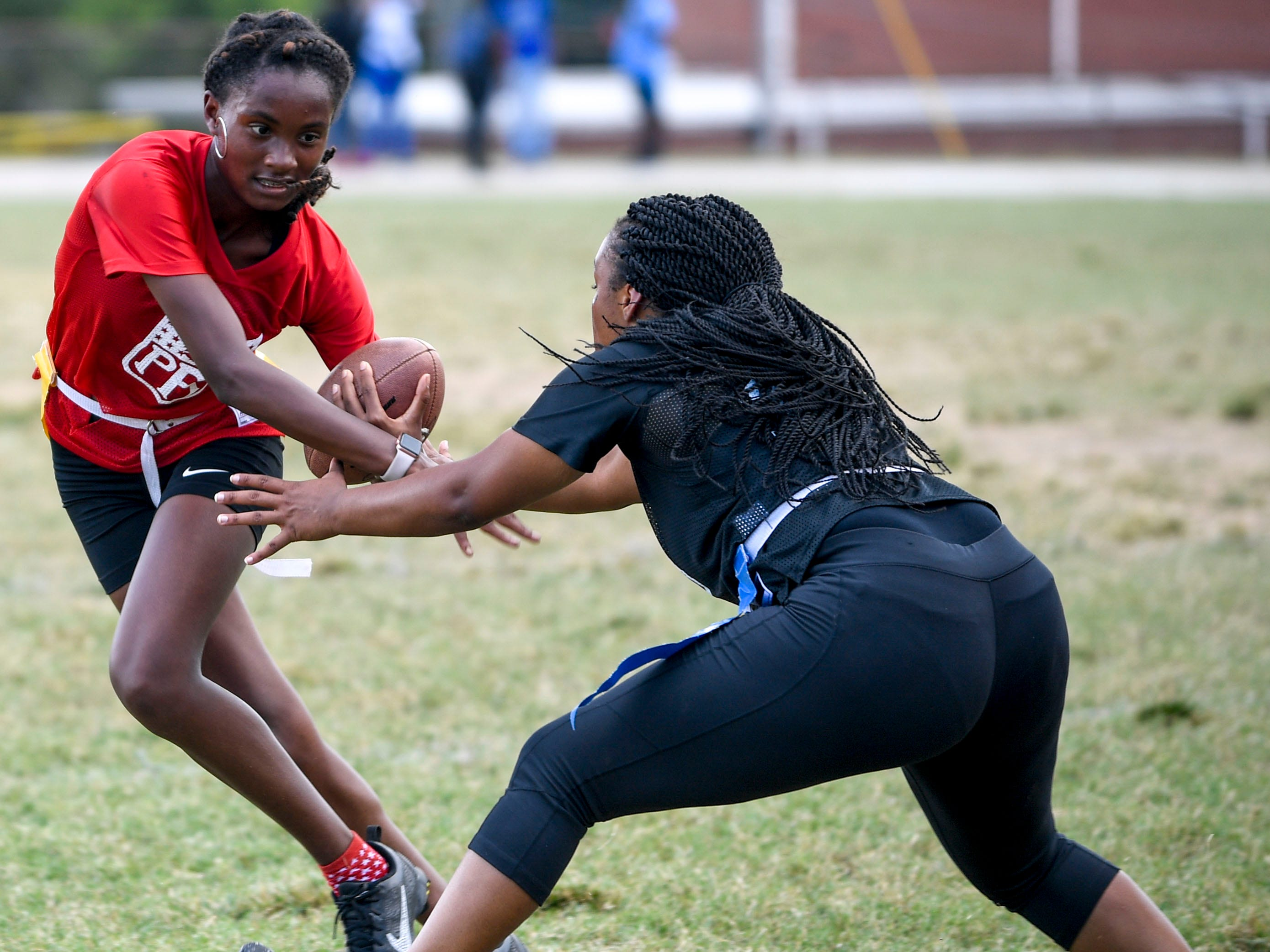 A sophomore player evades a senior defensive player during the 2017 Powder Puff game at Madison Academic High School in Jackson, Tenn., on Friday, Sept. 21, 2018.