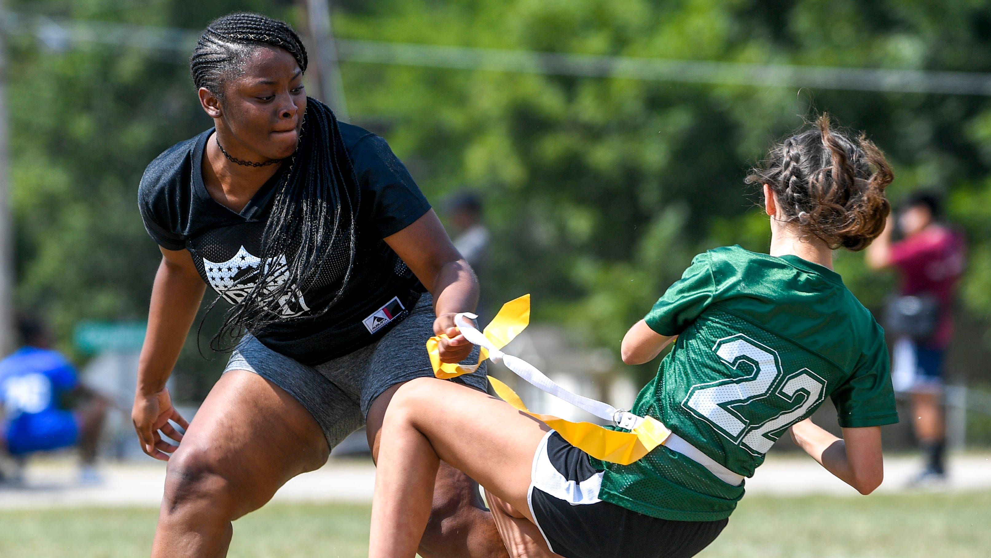 A senior defender pulls the freshman quarterback down to the ground during the 2017 Powder Puff game at Madison Academic High School in Jackson, Tenn., on Friday, Sept. 21, 2018.