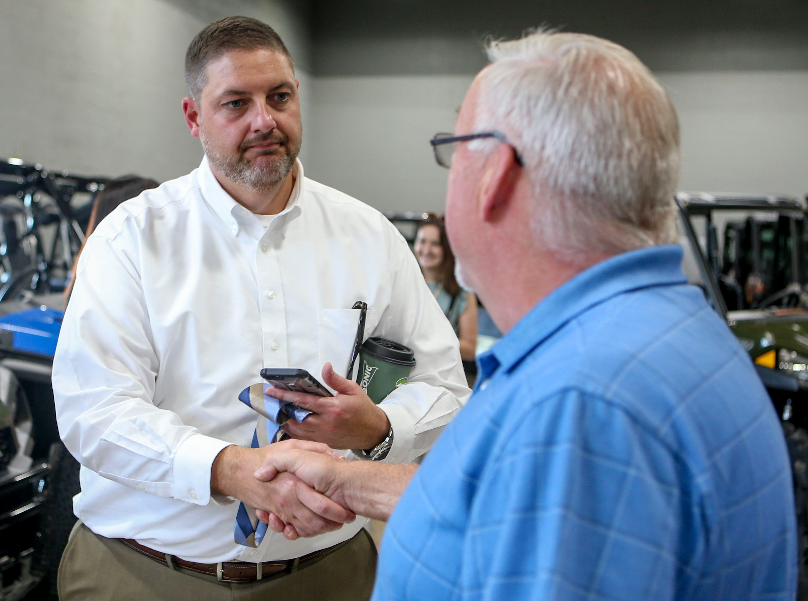 John Coleman, right, shakes the hand of and thanks John Miller, CEO of Lifeline Blood Services, left, who thanked him for his donation of blood at Bob's House of Honda in Jackson, Tenn., on Thursday, Sept. 20, 2018.