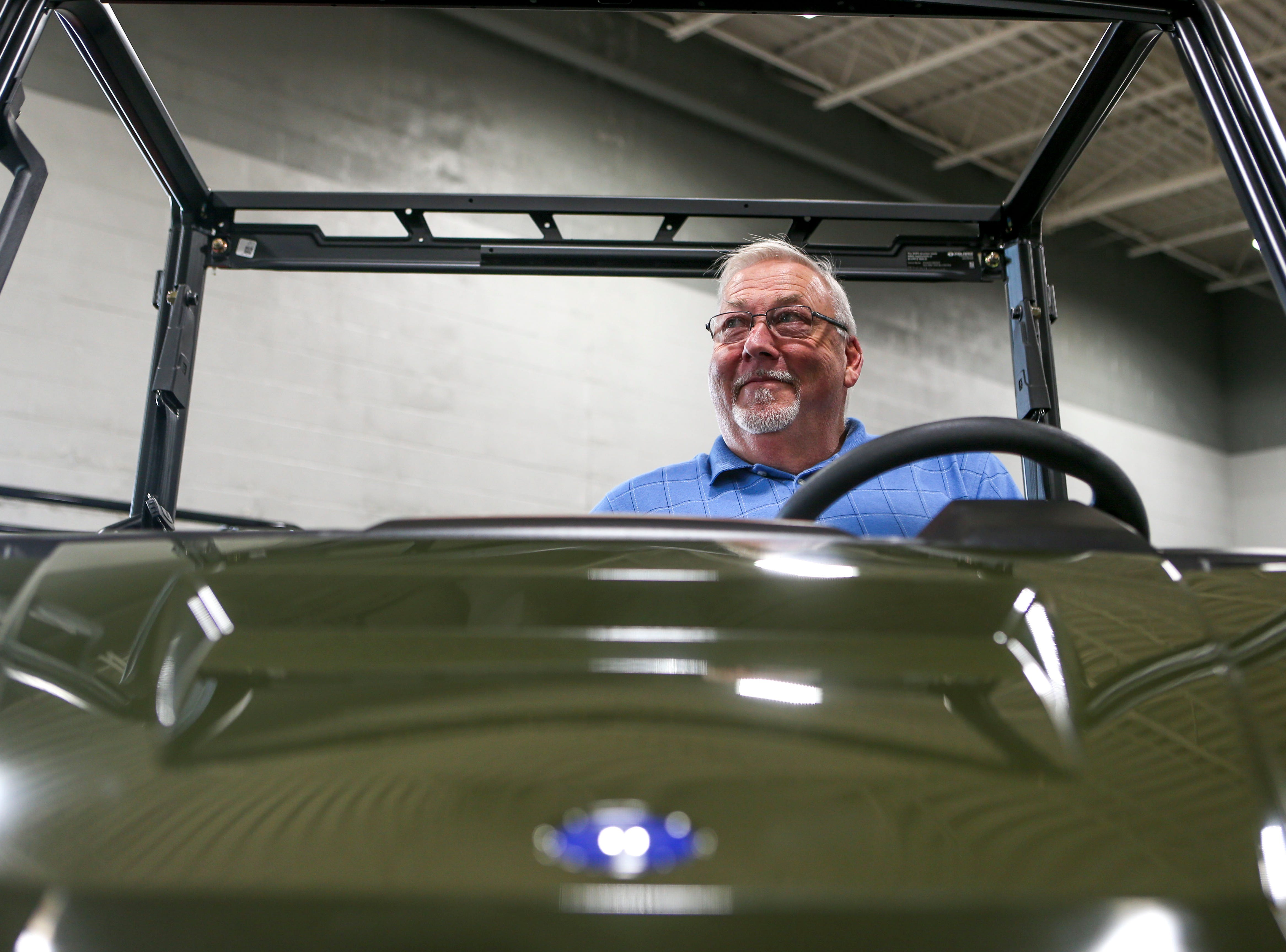 John Coleman, the winner of a Polaris Ranger ATV, sits in the drivers seat of a model vehicle at Bob's House of Honda in Jackson, Tenn., on Thursday, Sept. 20, 2018.