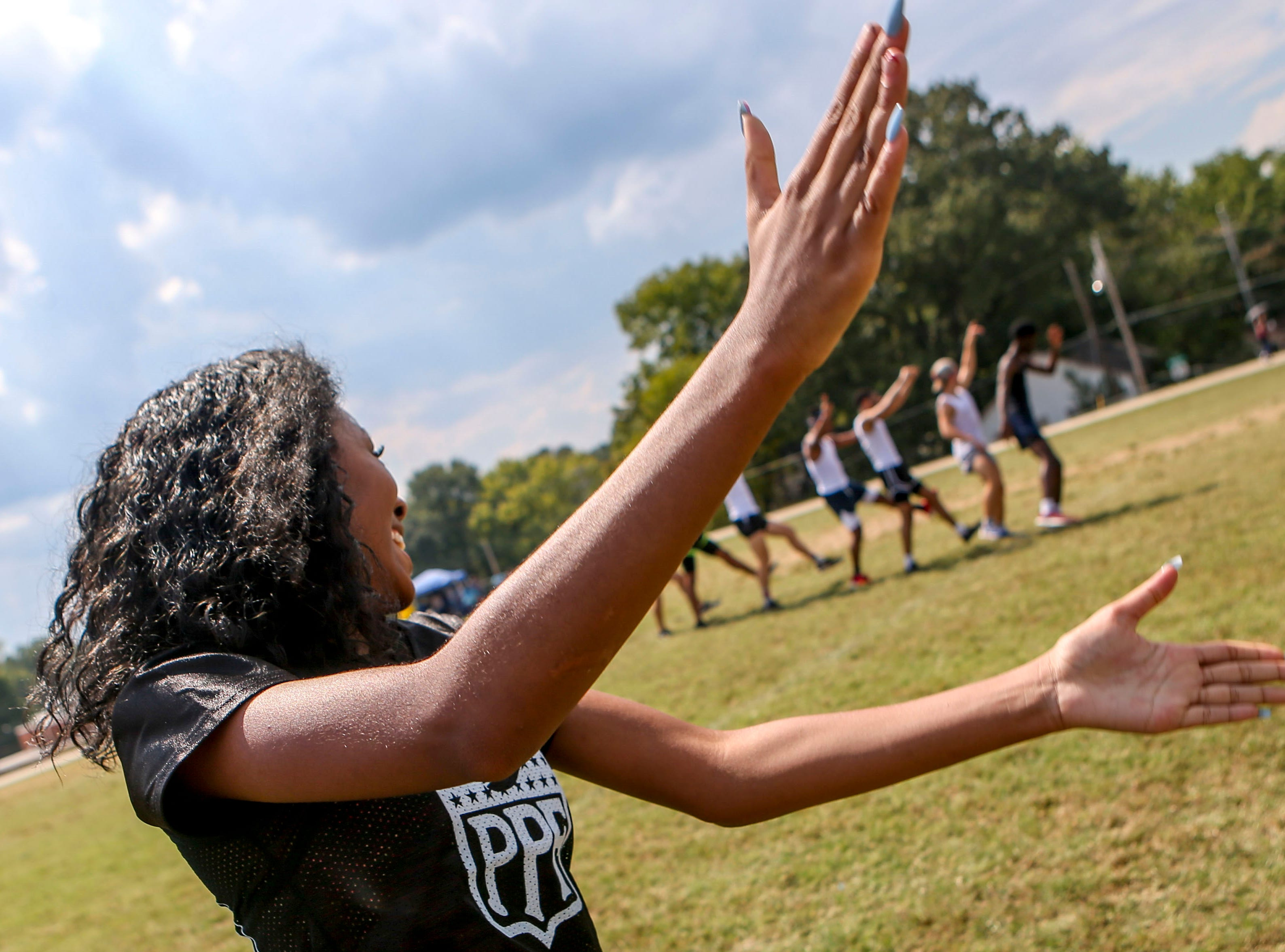 "A senior player dances for the ""Lady Mustangs"" to follow along to during their half time performance during the 2017 Powder Puff game at Madison Academic High School in Jackson, Tenn., on Friday, Sept. 21, 2018."