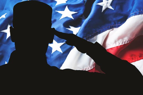 Proud saluting male army soldier on american flag background (Memorial day, Veteran's day, 4th of july, Independence day)