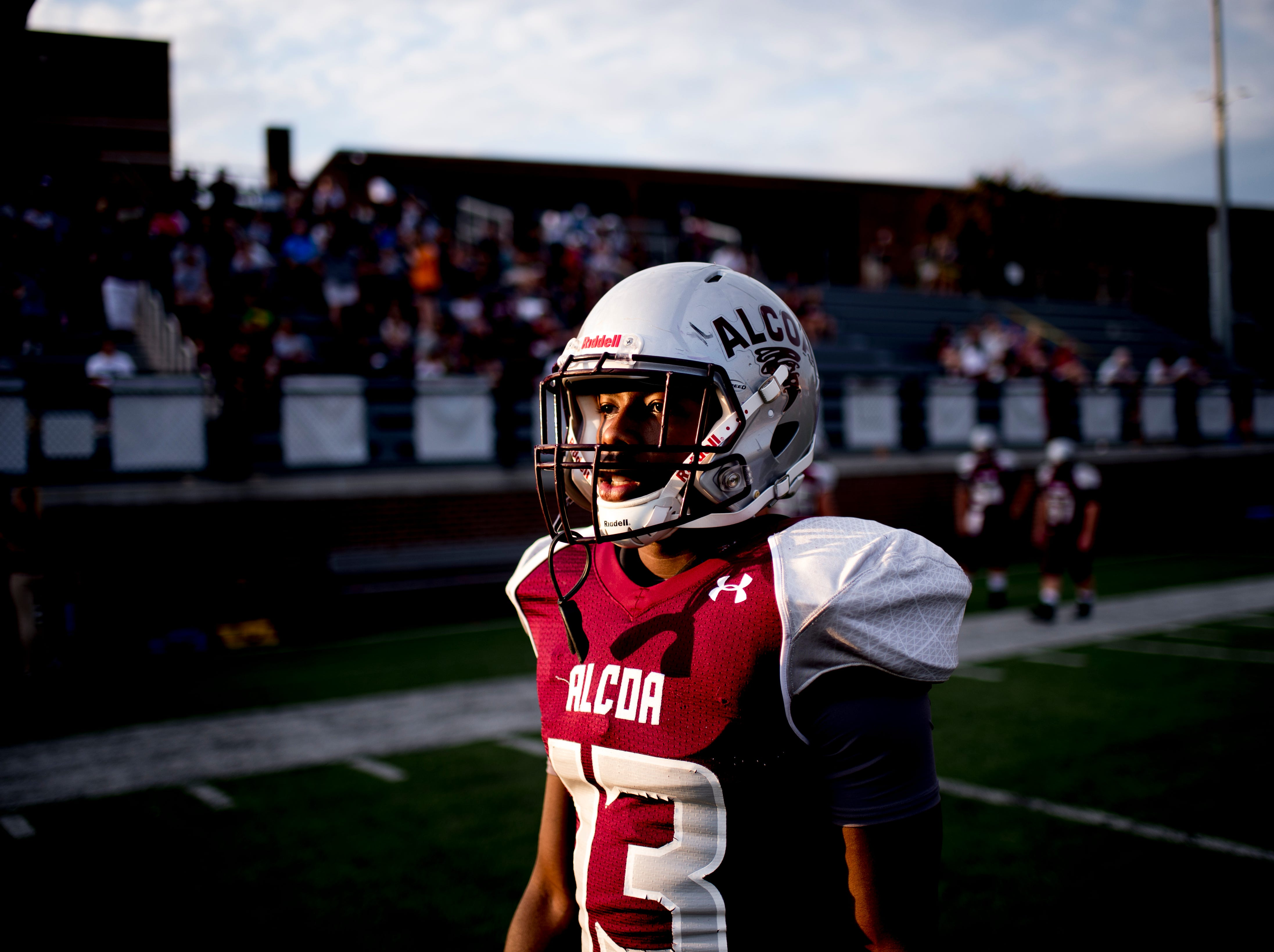 Alcoa's Ronald Jackson (13) warms up on the field during a game between Alcoa and Dobyns-Bennett at Alcoa High School in Alcoa, Tennessee on Friday, September 21, 2018.
