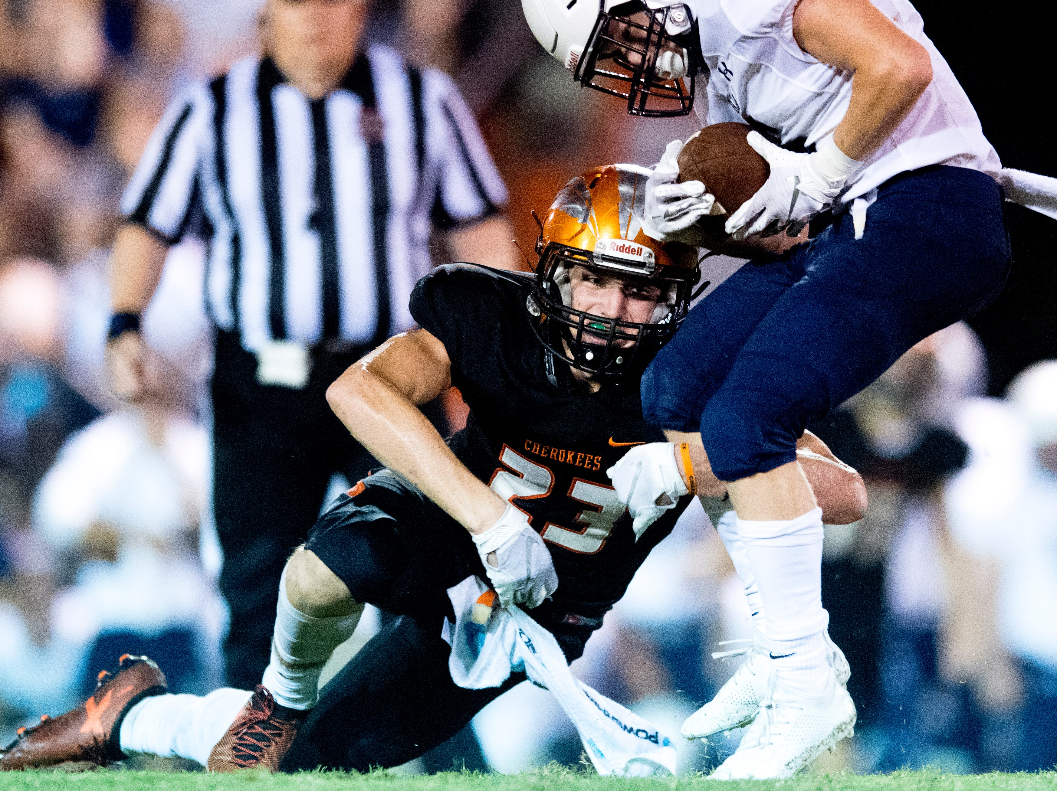 Greenback's Holden Willis (23) defends against Grace Christian's Grant Warwick (6) during a football game between Greenback and Grace Christian at Greenback High School in Greenback, Tennessee on Thursday, September 20, 2018.