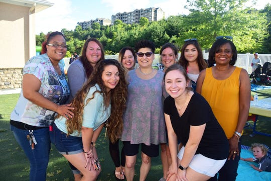 The staff of The Goddard School at a 10th Anniversary Birthday Bash Saturday, Sept. 15. (Front) Jessica Lewis, Anoula McCarren, owner; Katie Eikenberry; (back) Charlie Young, Rachel Shearer, Kaci Doster, Tonya Ray, Gabby Martinez, and Ola Stone.