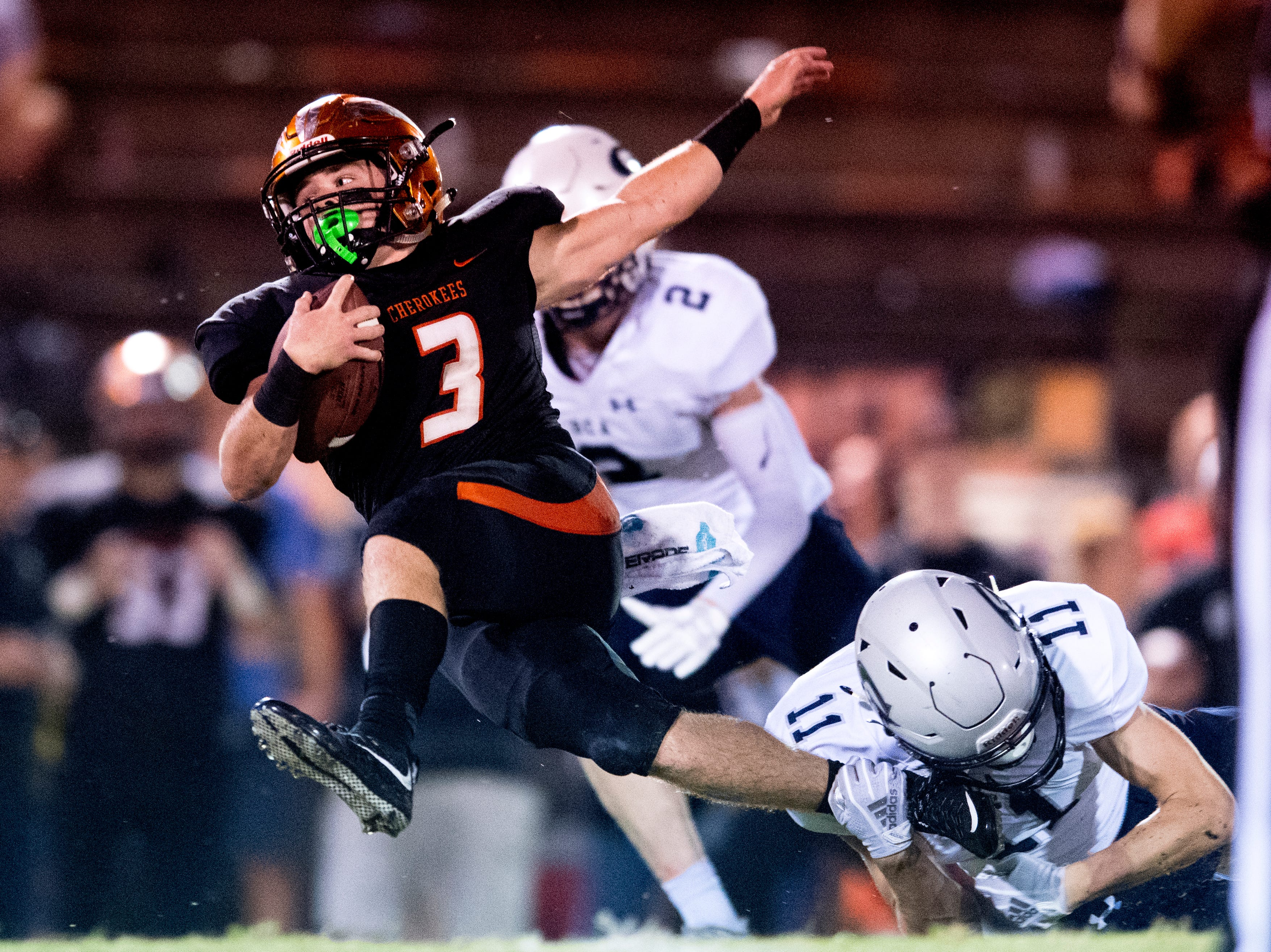 Greenback's Bryce Hanley (3) is tripped up by Grace Christian's Jared Long (11) during a football game between Greenback and Grace Christian at Greenback High School in Greenback, Tennessee on Thursday, September 20, 2018.