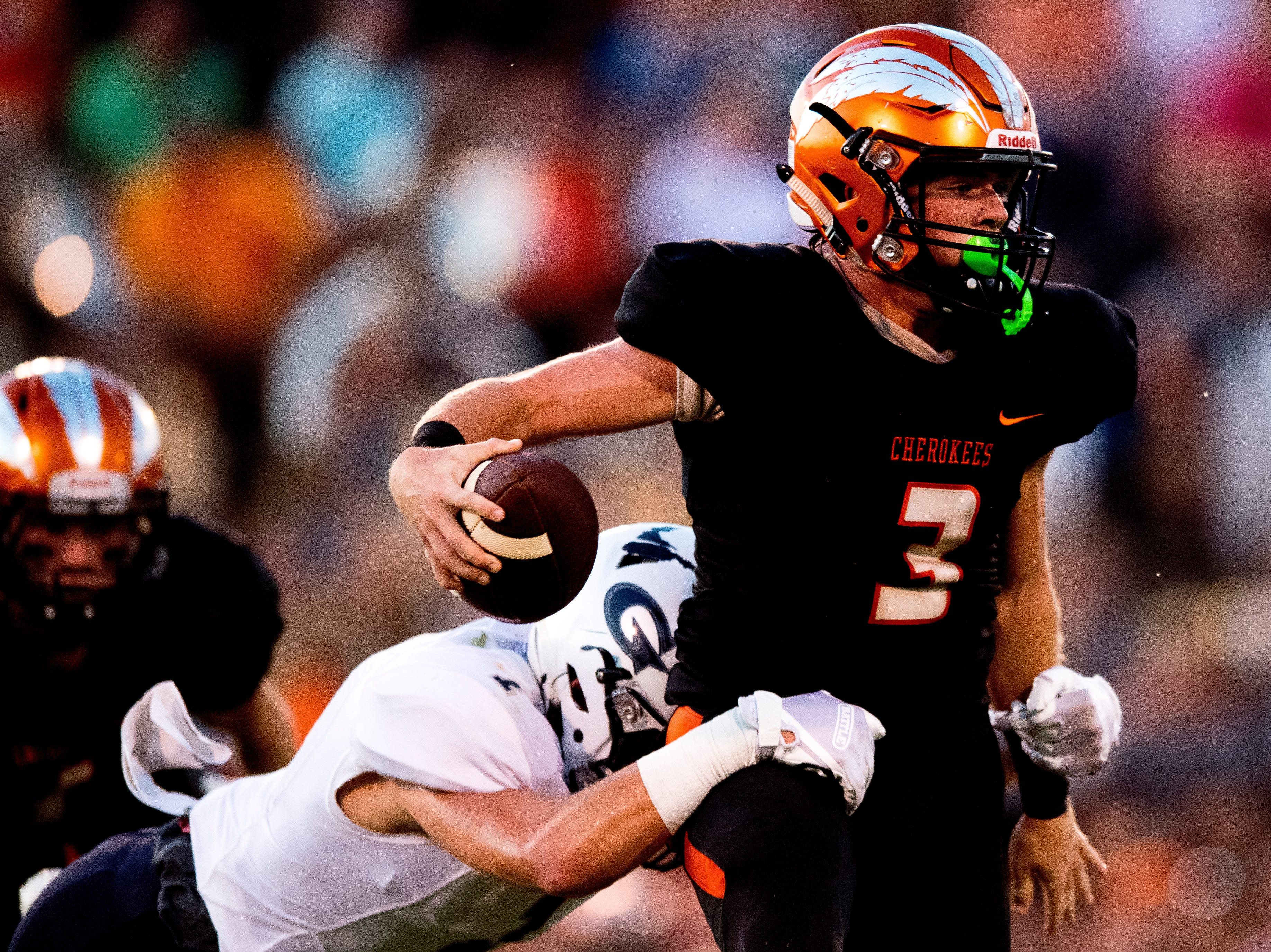 Greenback's Bryce Hanley (3) is attacked by Grace Christian's Michael Feiden (1) during a football game between Greenback and Grace Christian at Greenback High School in Greenback, Tennessee on Thursday, September 20, 2018.