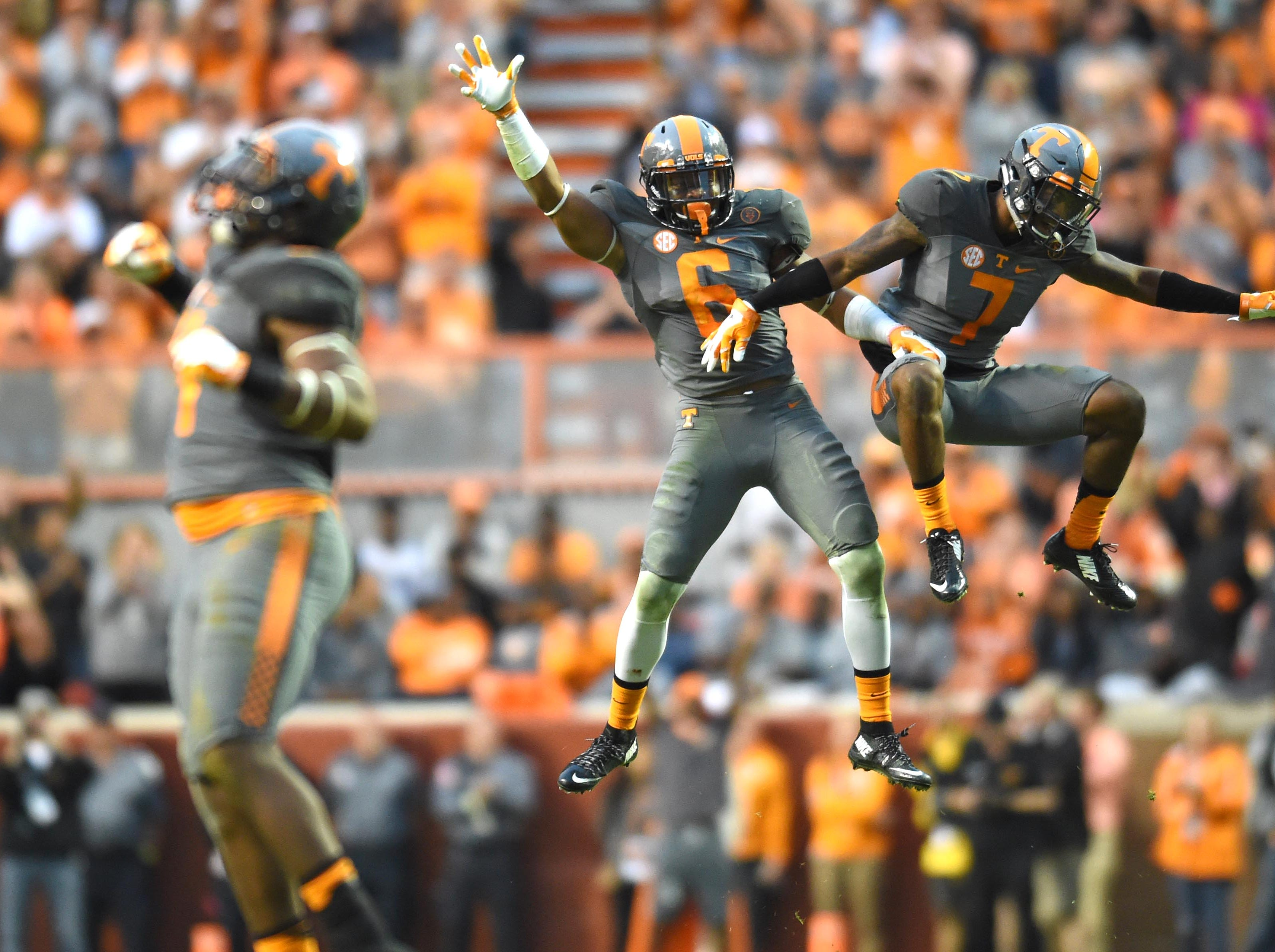 Tennessee defensive backs Todd Kelly Jr. (6) and  Cameron Sutton (7) celebrate Sutton's play denying Georgia a pass completion during the second half Saturday, Oct. 10, 2015, at Neyland Stadium. Tennessee came back from a 21-point deficit to win 38-31.