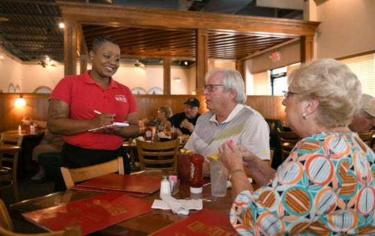 Waitress Tiffy Pirtle waits on Steve and Sharon Mays at Louis Restaurant Tuesday, September 11, 2018. Knox.biz feature on the business at 4661 Old Broadway.