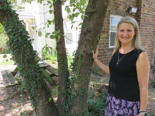 Ellen Rochelle by old dogwood tree in front of home