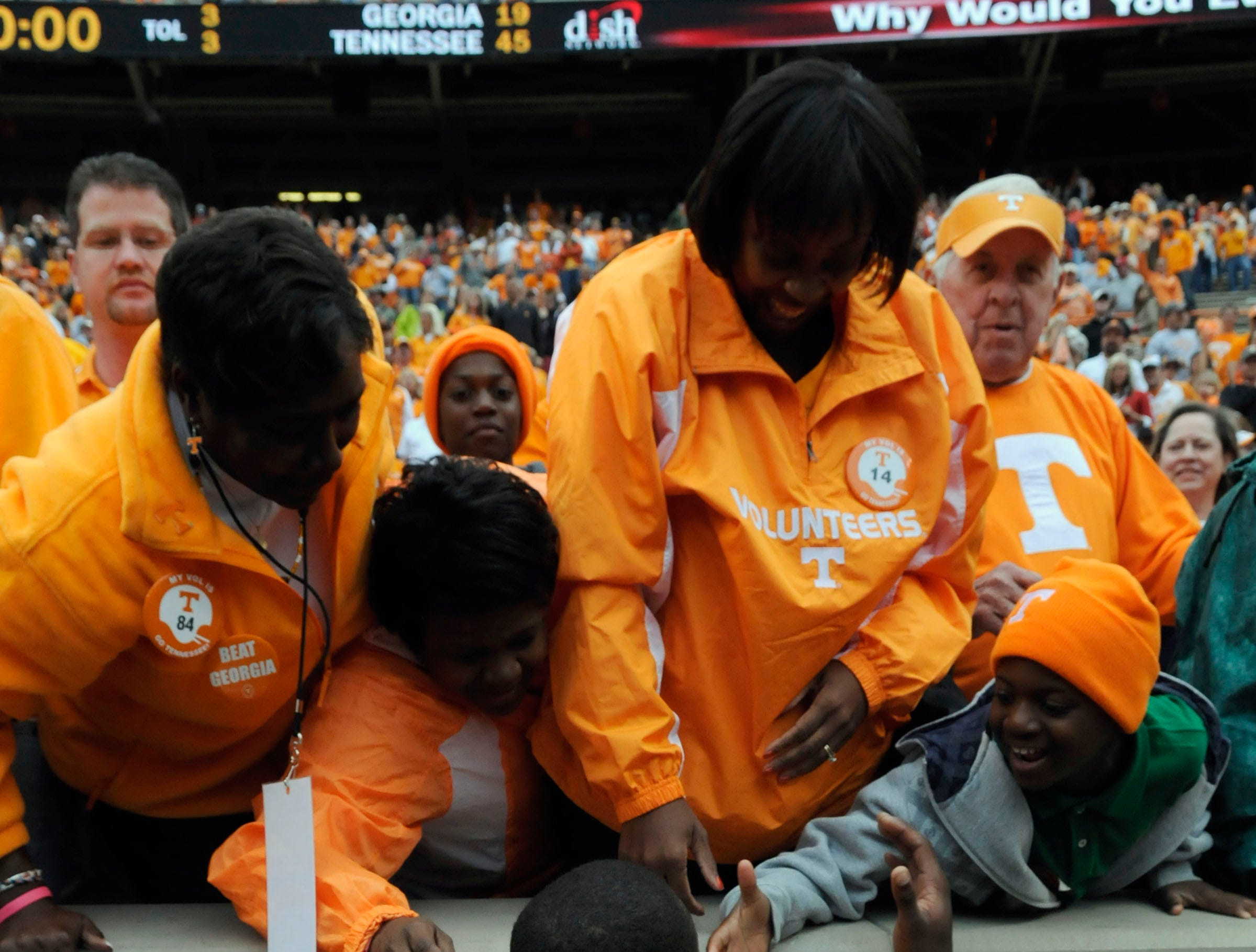 Tennessee cornerback Eric Berry (14) celebrates a victory with his family following Tennessee's 45-19 win over Georgia on Saturday, Oct. 10, 2009 at Neyland Stadium.