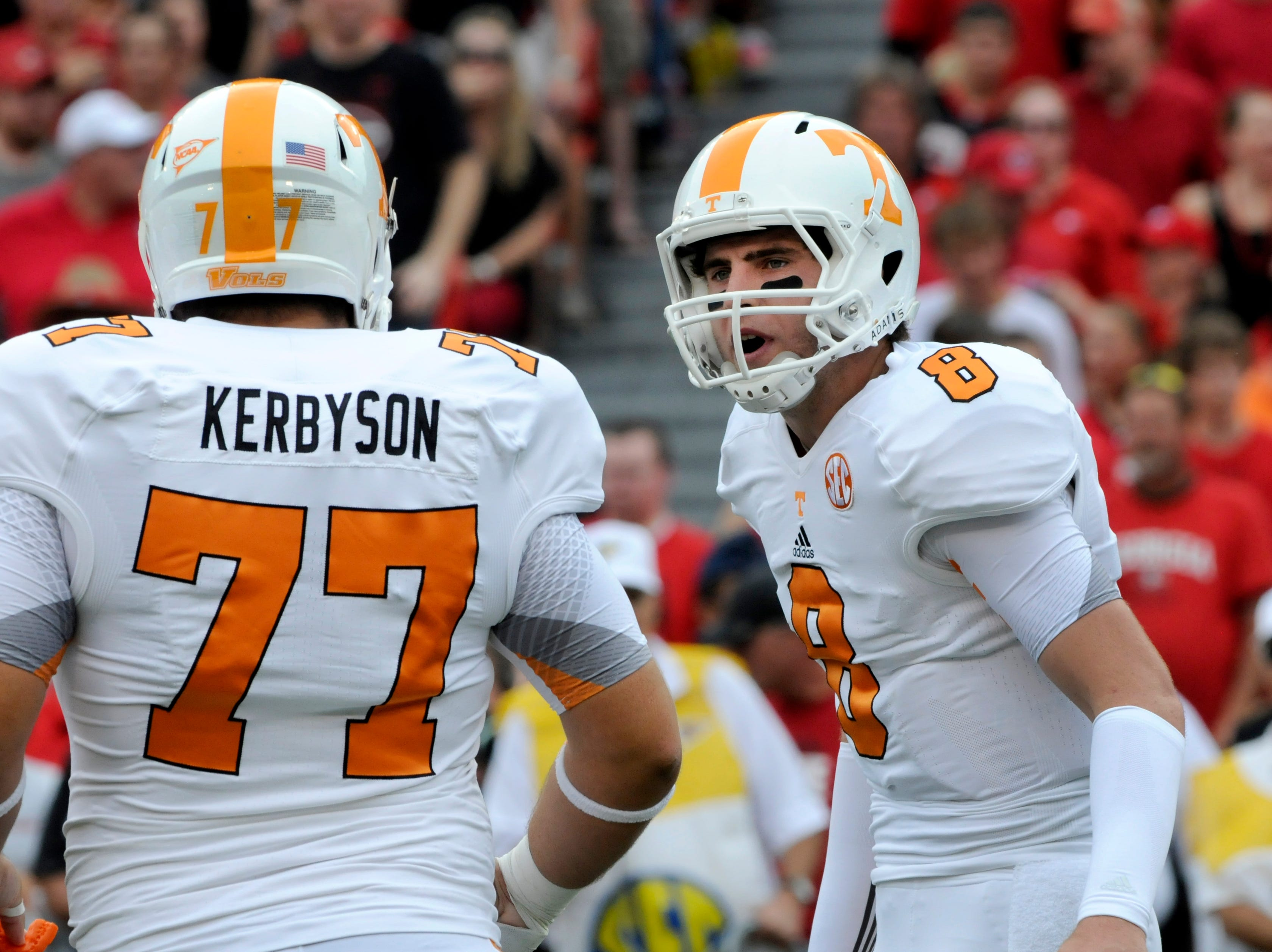 Tennessee Volunteers quarterback Tyler Bray (8) gives an audible play change to offensive linesman Kyler Kerbyson (77) during their 51-44 loss to Georgia Saturday, Sep. 29, 2012 in Sanford Stadium in Athens, Ga.