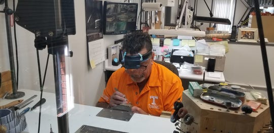 Jeweler Rick Terry works on a design in his Farragut store.