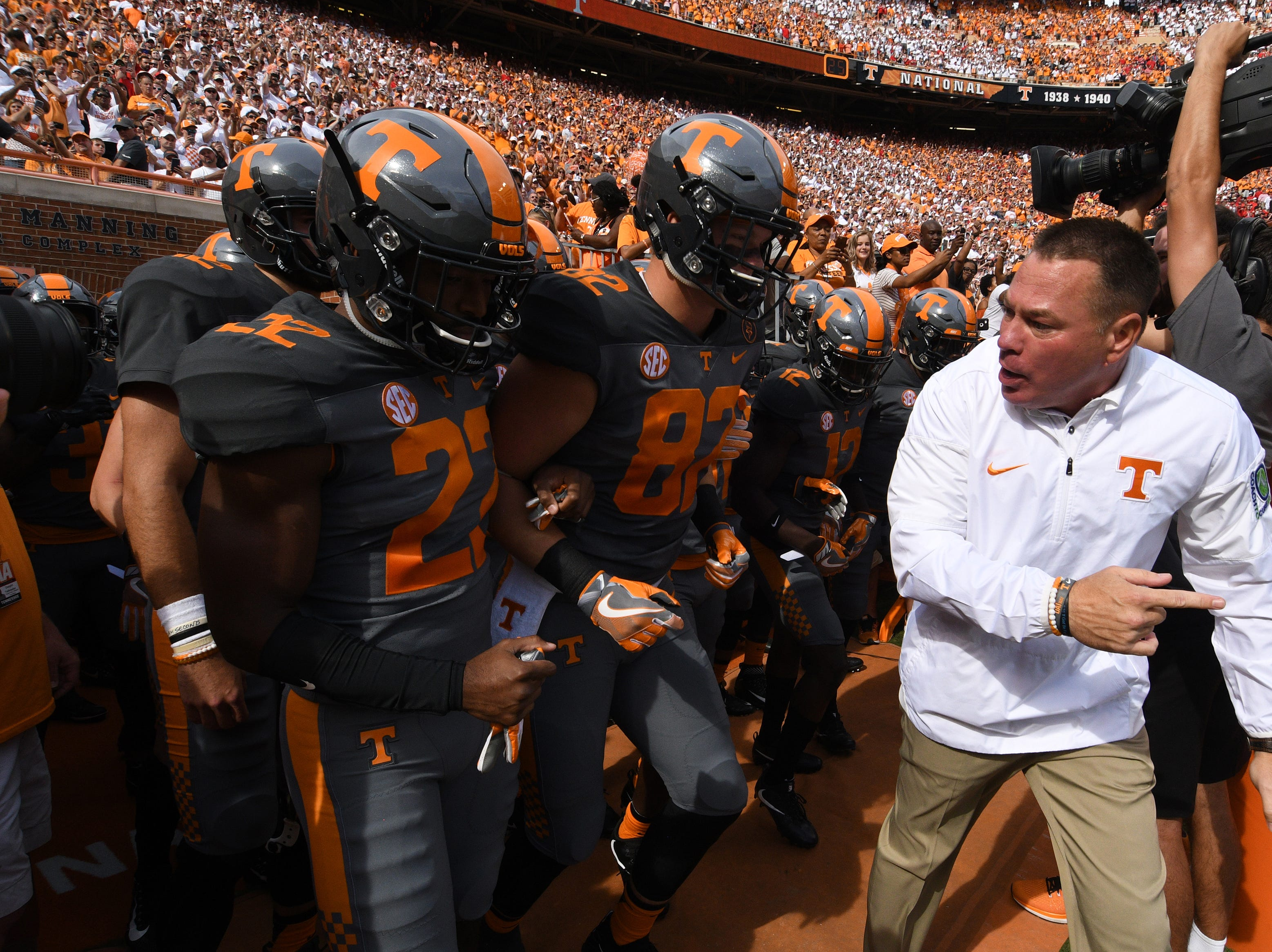 Tennessee Head Coach Butch Jones runs out of the locker room with the team during the Tennessee Volunteers vs. Georgia Bulldogs game at Neyland Stadium in Knoxville, Tennessee on Saturday, September 30, 2017.