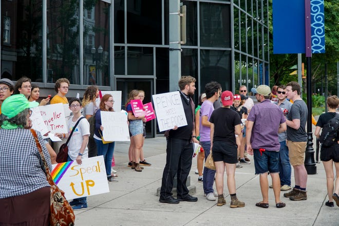Demonstrators gather outside First Tennessee Plaza on Friday, September 21 to protest a visit by Vice President Mike Pence.
