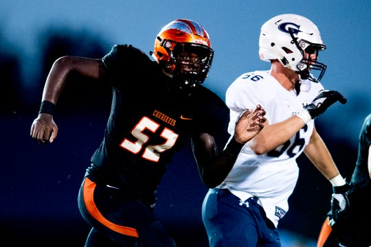 Greenback's Derrell Bailey (52) defends against Grace Christian's Wes Dorsey (66) during a football game between Greenback and Grace Christian at Greenback High School in Greenback, Tennessee on Thursday, September 20, 2018.