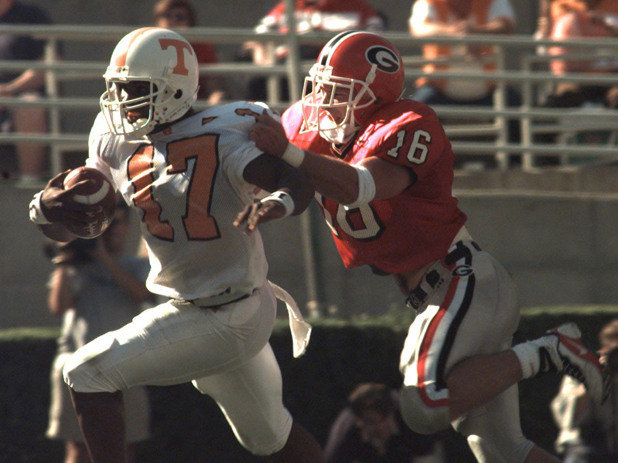Vols Tee Martin gets chase out of the pocket by Georgia's Kirby Smart Saturday in Athens, GA, on October 10, 1998.