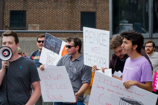 Close to 30 people joined a protest outside First Tennessee Plaza Friday evening to demonstrate against a visit by Vice President Mike Pence and Senate candidate Marsha Blackburn.