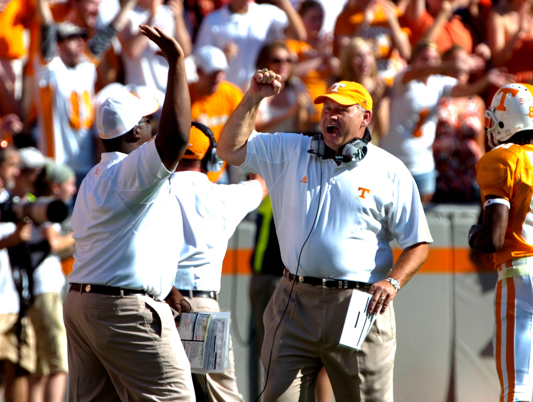 Tennessee head coach Phillip Fulmer, right, celebrates with Gerald Harrison after LaMarcus Coker's 56-yard touchdown catch against Georgia on Saturday at Neyland Stadium. The Vols beat 12th-ranked Georgia 35-14, improving to 3-2 for the season. Harrison is the Vols' director of high school relations.