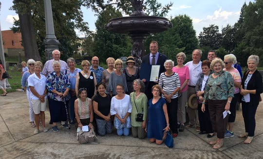 "The KCPL Friends of the Library and other distinguished guests gather around Mayor Glenn Jacobs, who is holding the official proclamation declaring Sept. 19 ""Mary Utopia Rothrock Day."" Shown are (l, rear) Flossie McNabb and Fred Brackney; (middle) Priscilla Siler, Marye Rose, Betsy Roberts, Rusha Sams, Viren Lalka, Ginna Mashburn, Sharon Smith, Mary Pom Claiborne, Mayor Jacobs, Julie Webb, Bonny Naugher, Jack Neely, Jean Idell, John Williams, Carolyn Jensen, Laurie Pearl, KCPL president Myretta Black (partially obscured) and Jinx Watson; (front) Linda Sammataro, Claire Serrell, Maggie Carini, Judy Loest and Martha Edington."