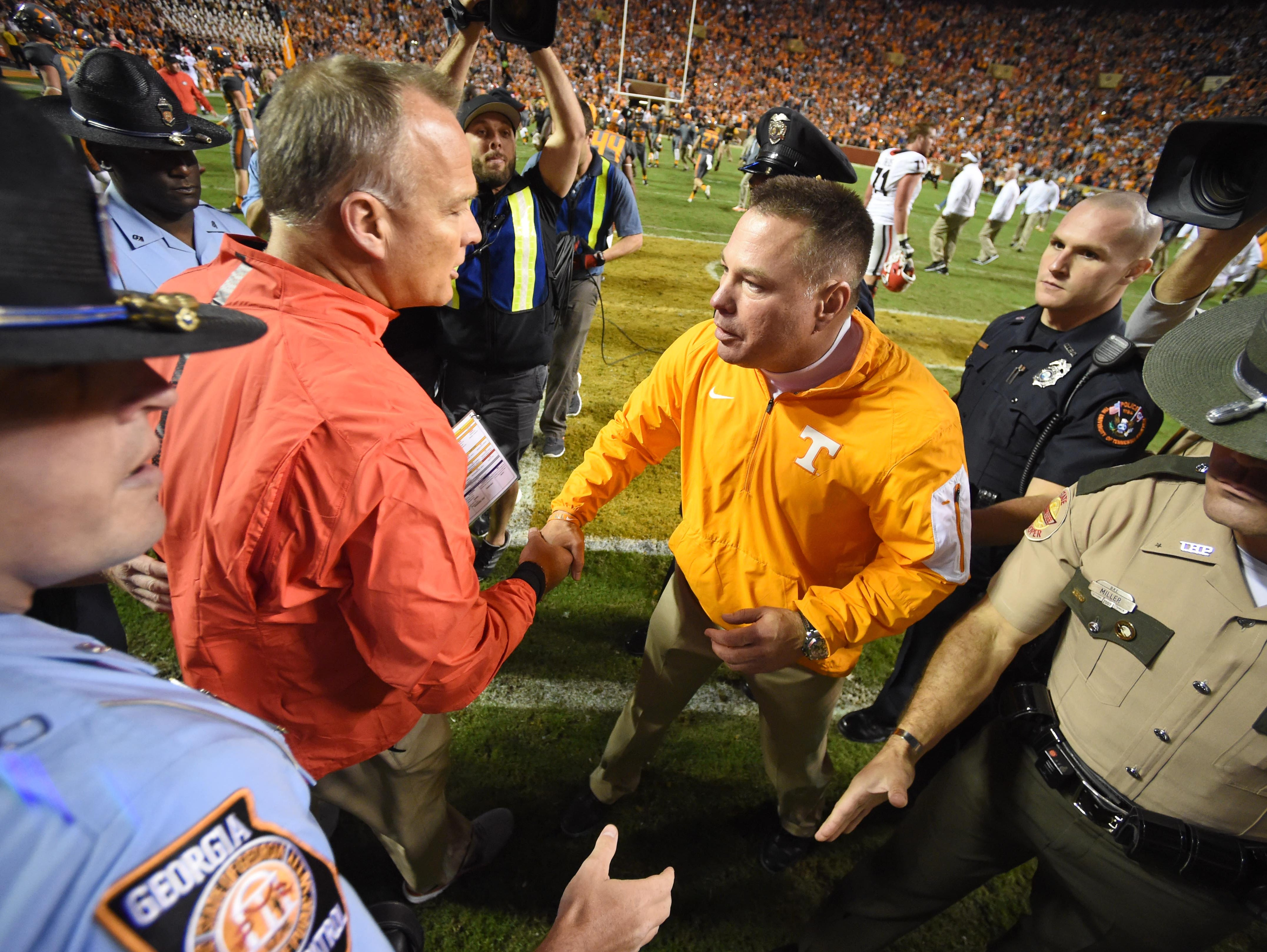 Tennessee coach Butch Jones, right, shakes hands with Georgia coach Mark Richt after the Vols' 38-31 victory over the Bulldogs Saturday, Oct. 10, 2015, at Neyland Stadium.