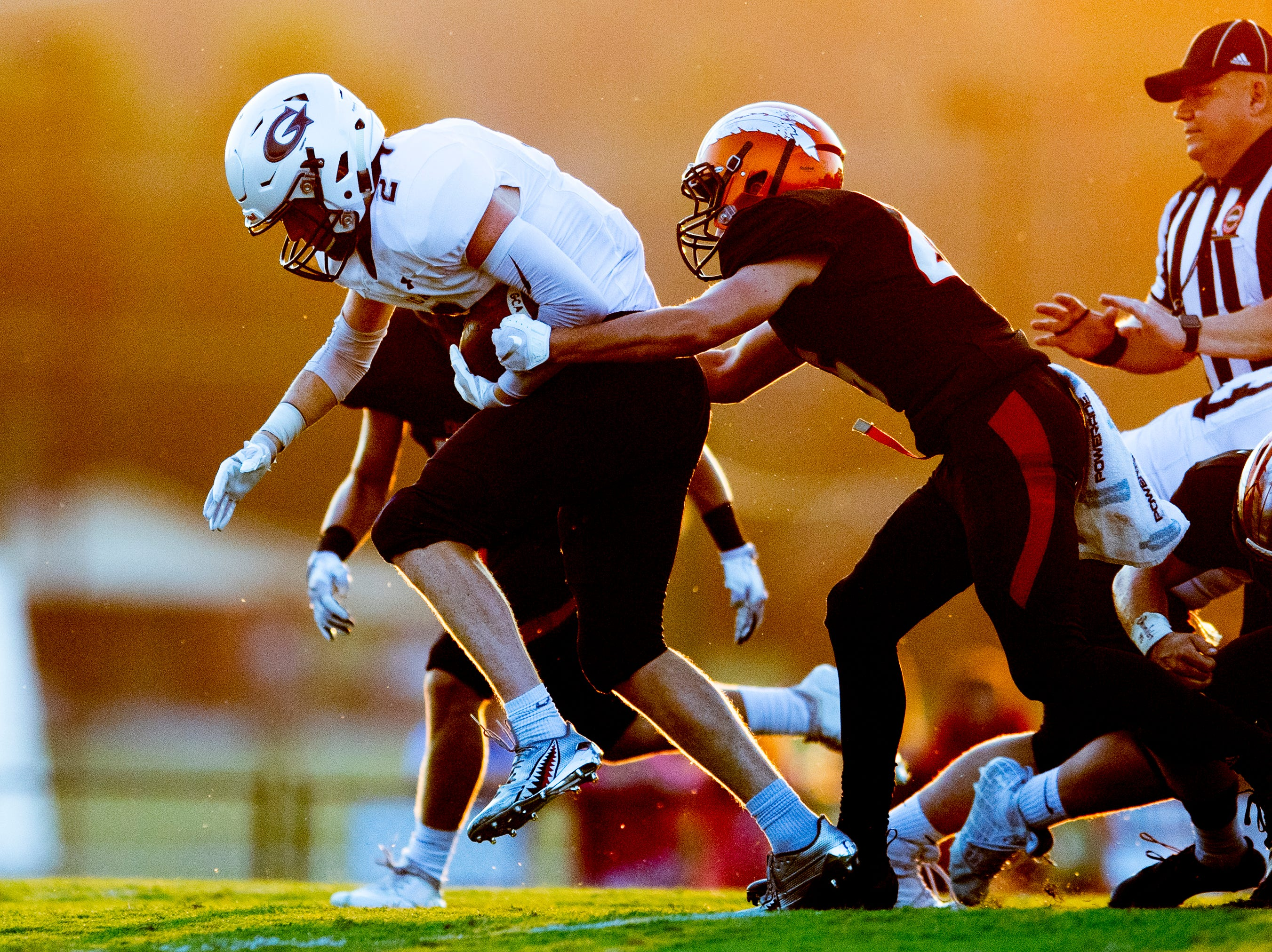 Grace Christian's Chandler Williams (2) tries to break away from Greenback's Blake Morton (26)  during a football game between Greenback and Grace Christian at Greenback High School in Greenback, Tennessee on Thursday, September 20, 2018.