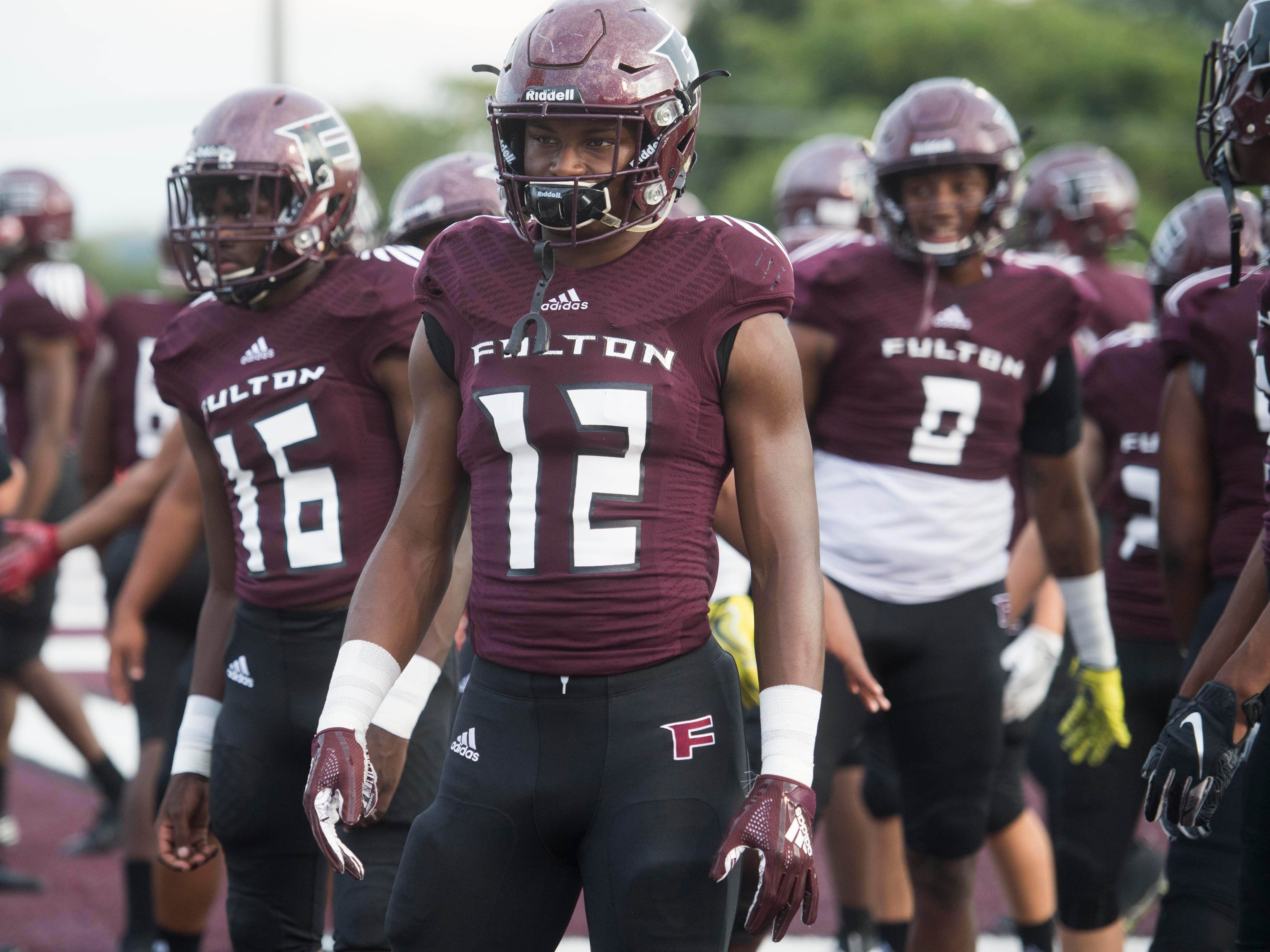 Fulton players gather for the start of the football game against Maryville on Friday, September 21, 2018.