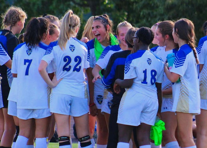 Kayla Forbes, center, celebrates the win with her teammates at Kingston High School Tuesday, Sept. 4.